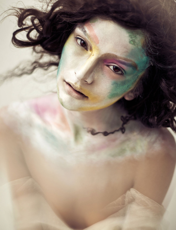 Brunette female model with pale face and colorful makeup by Nika Vaughan