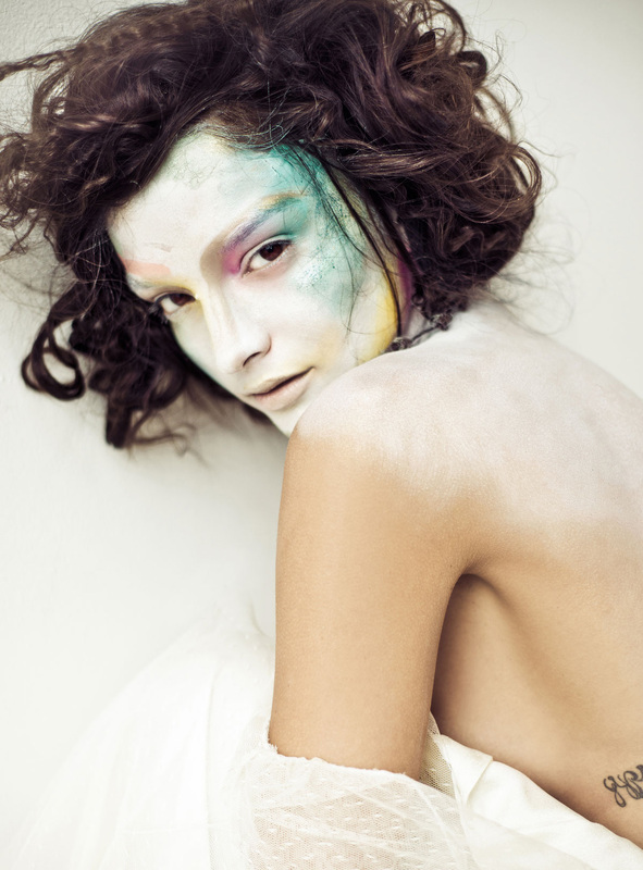 Model with pale face and colorful makeup by Nika Vaughan